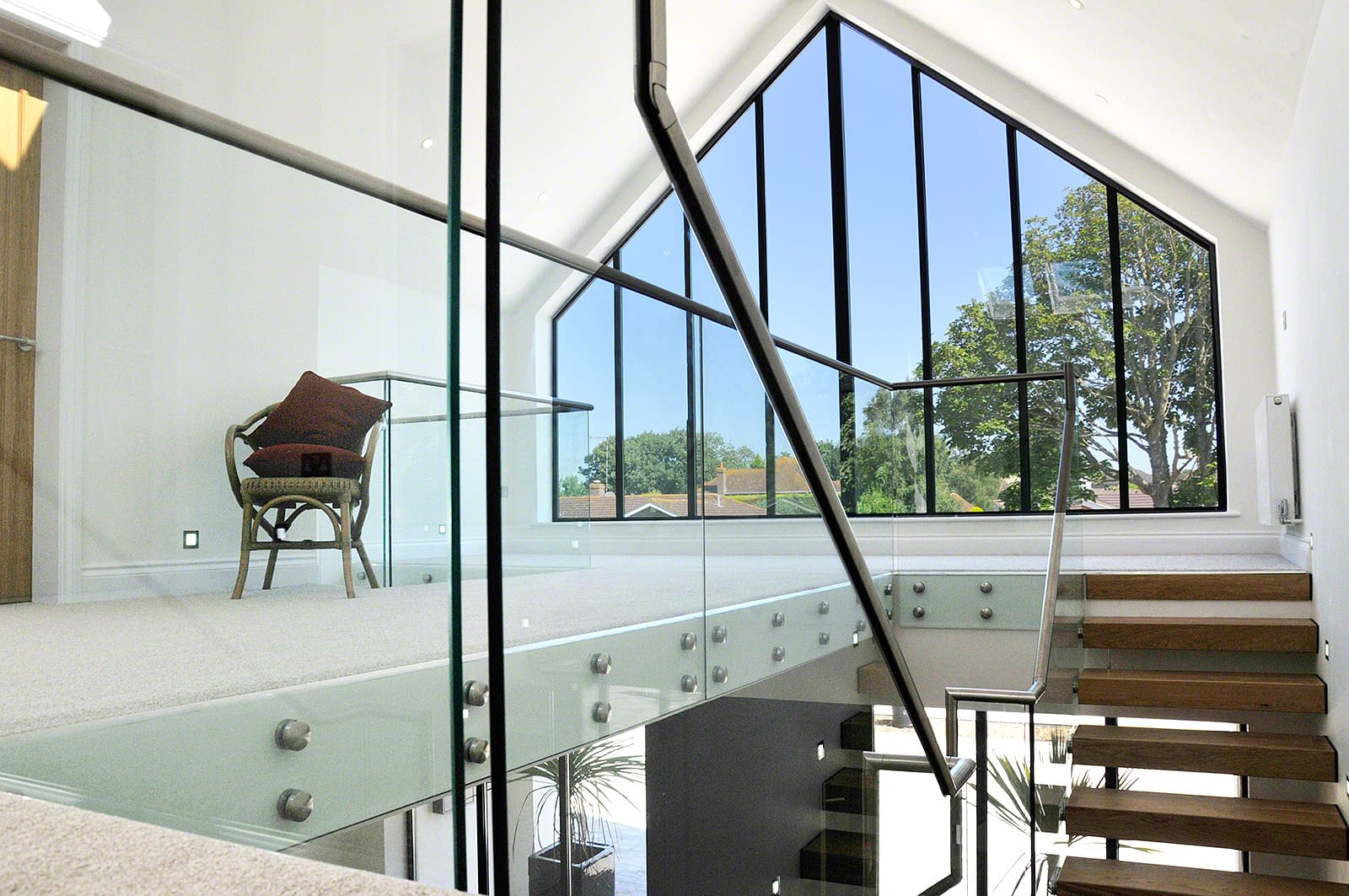 Glass Standoff Buttons on staircase in a modern home