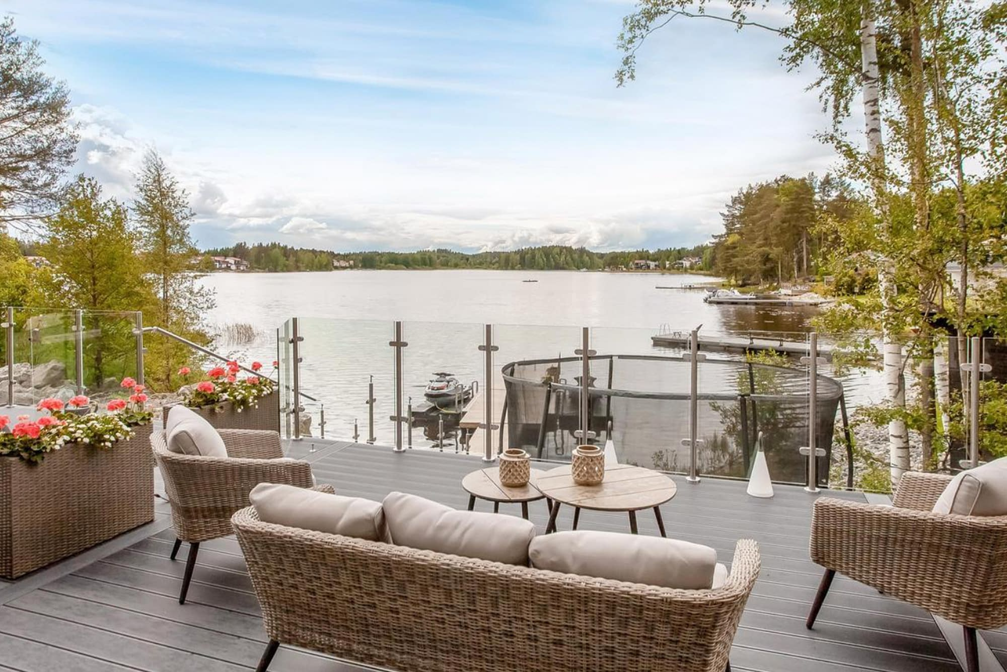 Semi-Framed Stainless Steel Ultimate Balustrade System Overlooking a Lake in Finland