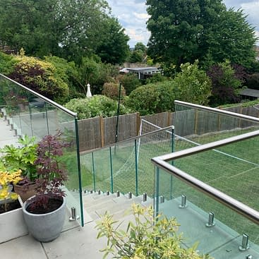 Frameless 2205 Duplex Stainless Steel Spigot Balustrade on Concrete Patio