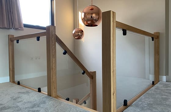 Toughened Glass with Flat Back Glass Clamps on Wooden Staircase